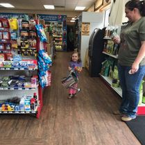 Young girl shopping in the Pit Stop Convenience store